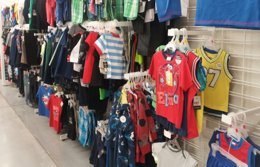 And here's the boys' aisle. Notice the difference? Why aren't there any pink shirts, shorts or pants?
