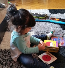My beloved flipping her favourite book with her left hand :)
